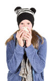 Young girl with jacket and wooly hat holding cup. Isolated on white background Stock Photo