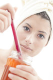 Young girl with a jar of honey Stock Photography
