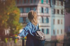 Young girl in jeans jacket on streets of Strasbourg Royalty Free Stock Photos