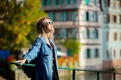 Young girl in jeans jacket and sunglasses on street of Strasbourg. France. Autumn season time stock images