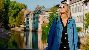 Young girl in jeans jacket and sunglasses on street of Strasbourg. France. Autumn season time royalty free stock images