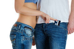 Young girl in jeans and a naked stomach stealing credit card from man. Young girl in jeans and a naked stomach stealing a credit card from man Royalty Free Stock Photo