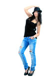 Young girl. The girl in jeans, undershirts and a hat royalty free stock image