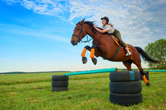 Young girl jockey and her horse jumper. Pretty young girl jockey and her horse jumper Stock Photo