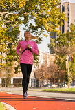 Young girl jogging Royalty Free Stock Photos