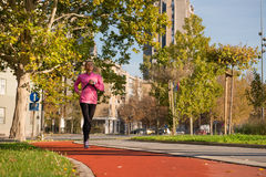 Young girl jogging Royalty Free Stock Photo