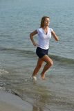 Young girl jogging Stock Photo