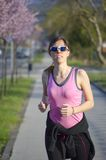 Young girl jogging outdoors Royalty Free Stock Photos