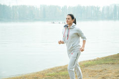 Young girl jogging outside in the park Royalty Free Stock Photography