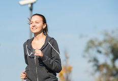 Young girl  jogging Stock Image
