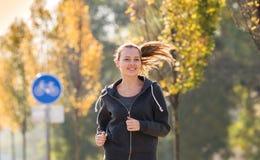 Young girl  jogging Stock Photos