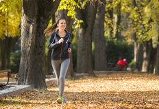 Young girl  jogging Royalty Free Stock Photography