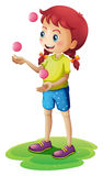 A young girl juggling Royalty Free Stock Photos
