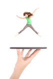 Young girl jump using tablet pc on people hand Stock Photo