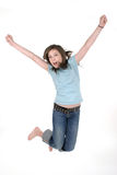 Young Girl Jumping 1. Young pre teen or tween girl jumping up in the air with arms outstretched. Shot on white stock photos