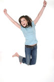 Young Girl Jumping 2. Young pre teen or tween girl jumping up in the air with arms outstretched.  Shot on white Stock Image