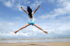 Young girl jumping in the air Royalty Free Stock Image