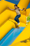 Young girl jumping on attractions Royalty Free Stock Photography
