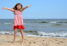 Young girl jumping on the beach Royalty Free Stock Image