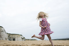 Young girl jumping on a beach Royalty Free Stock Photography