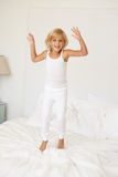 Young Girl Jumping On Bed Royalty Free Stock Photo