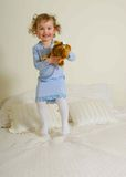 Young girl jumping on bed Royalty Free Stock Photography