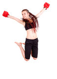 Young girl jumping with boxing gloves Royalty Free Stock Photography