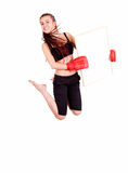 Young girl jumping with boxing gloves and blank card Stock Photo