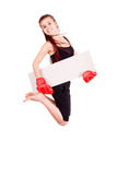 Young girl jumping with boxing gloves and blank card Stock Photography