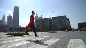 Young girl jumping by crosswalk with jump rope with urban background of Dubai in slow motion