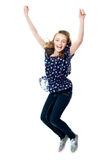 Young girl jumping in excitement Royalty Free Stock Photography