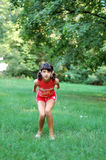 Young girl jumping in field Stock Image