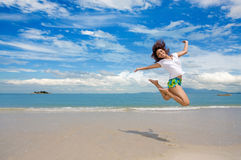 Young girl jumping gracefully at the beach royalty free stock photo