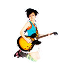 Young girl jumping with a guitar royalty free stock photography
