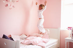 Young Girl Jumping On Her Bed stock photo