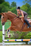 Young girl jumping on horse Royalty Free Stock Images