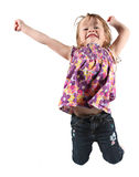 Young girl jumping for joy Stock Photography