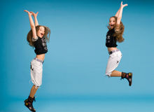 Young girl jumping of joy Royalty Free Stock Photos
