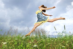 Young girl jumping in meadow Royalty Free Stock Photography