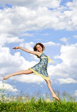 Young girl jumping in meadow Stock Photos