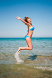Young girl jumping out of  water Stock Images
