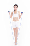 Young girl jumping rope, white background Royalty Free Stock Photography