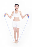 Young girl jumping rope, white background Royalty Free Stock Photo