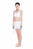 Young girl jumping rope, white background royalty free stock photos
