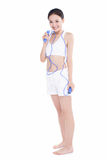 Young girl jumping rope, white background Stock Photo
