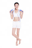 Young girl jumping rope, white background Stock Photography