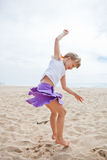 Young girl jumping in sand Royalty Free Stock Photography
