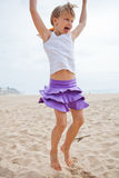 Young girl jumping in sand Royalty Free Stock Photos