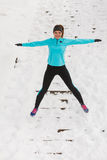 Young girl jumping on the snow. Stock Photos