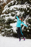 Young girl jumping in the snow. Royalty Free Stock Images